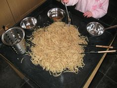 """Noodle exploration for Chinese New Year - from Pre-school Play ("""",) Chinese New Year 2017, Chinese New Year Crafts For Kids, Chinese New Year Activities, Chinese Crafts, New Years Activities, Eyfs Activities, Nursery Activities, Infant Activities, School Play"""