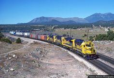 https://flic.kr/p/QZUM1f | Santa Fe Four Axle Quartet | A quartet of four axle units with GP50 No. 3818 in the lead, pull a Santa Fe intermodal train east through Winona, Arizona on Oct. 1, 1988.