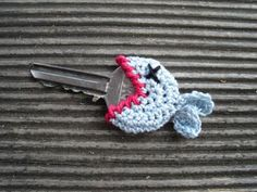 Dead Fish crochet key cover.. is this crafty or is it funny? I have a feeling this would get in the way, but boy would it be easy to know what key you are looking for in the dark!