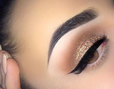 Nicely arched brow, gold glitter on lid with mocha in the crease and winged liner...very pretty!!:):)