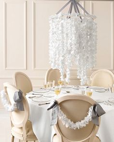 beautiful hanging centerpiece- part chandelier, part flower, part DIY.  could be made cheaply, will really anchor the tables, can bet lit from within with LED lights @Shannon o\'donnell
