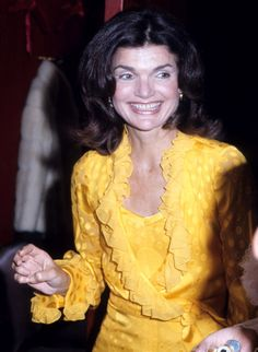 Jacqueline was all smiles at the Metropolitan Opera House in New York in May 1973.