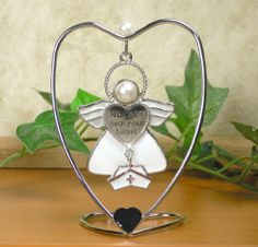 Nurses Heal Your Heart Hanging Ornament Angel with Hat Charm and Heart Stand.  Perfect gift for a graduating nurse.