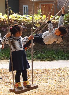 Children play on kune, traditional Korean swings.  Kunettwigi was once a common folk game enjoyed nationwide by anyone, regardless of age.  Participants would compete to see how high they could swing.  This game was particularly popular on special holidays.