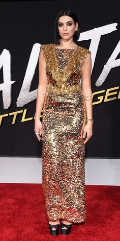 During the Alita: Battle Angel premiere, Dua Lipa smoldered in a glittery Prada gown and platform heels. Khaki Coat, Purple Gowns, Wedge, Beige Top, Couture Week, Red Carpet Looks, Gold Dress, Cool Outfits, Party Outfits