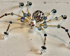 Beaded Spider Ornament | Etsy Beads And Wire, Metal Beads, Glass Beads, Beaded Spiders, Ceramic Christmas Tree Lights, Christmas Ornaments, Copper Wire Crafts, Wire Spider, Christmas Spider