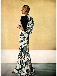 Salvadore Dali print Adrian gown-1947 (photo and lots more information on Adrian on http://www.bluevelvetvintage.com/vintage_style_files/2011/02/15/the-adrian-look-vogue-1947/) Back 'cape' drape similar to Mary Damon leopard print dress?