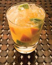The Tangerine Honey Caipirinha is an exotic variation of the classic Brazilian caipirinha drink recipe. An orange colored cocktail made from Leblon cachaca, tangerine, lime and honey, and served muddled in a rocks glass. Drinks Alcohol Recipes, Cocktail Recipes, Cocktails, Drink Recipes, Fun Drinks, Healthy Drinks, Caipirinha Cocktail, Mojito Recipe, Cocktail