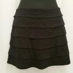 """Express Knitted Tired Mini Skirt Sexy black knitted skirt. Featuring a wide elastic waistband with exposed center back metal zipper closure. Seven layers of tiered knit all highlighting the body.  52% poly 48% modal  Machine Washable  30"""" waist 36"""" hips 40"""" sweep 15"""" overall length  Supper sexy fit. Like new Express Skirts Mini"""