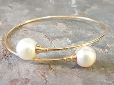 9ct Yellow gold spring bangle set with 2× South sea pearls. All handmade.