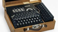 The german Enigma machine used to encrypt/decrypt secret messages during World War II. Cracked by Alan Turing and teams of mathematicians, cryptologists, and technologists at Bletchley Park based on previous work and discoveries in Poland and France.
