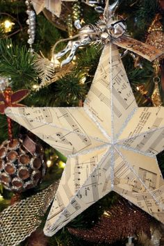 21 DIY Christmas Paper Decorations Music Paper Christmas Star tutorial from Sweet Something Designs The post 21 DIY Christmas Paper Decorations appeared first on Paper Diy. Christmas Spheres, Noel Christmas, All Things Christmas, Sheet Music Crafts, Music Paper, Sheet Music Ornaments, Diy Christmas Paper Decorations, Holiday Crafts, Paper Christmas Ornaments