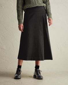 LONG BLACK DENIM SKIRT | Long, A-line skirt in a soft, medium-weight, black stretch denim. Asymmetric with inverted box pleat and sewn-in at front