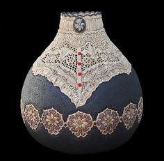 """Tea and Crumpets"" is the title of this gourd carving by Jordan Straker, a gourd decorated with carved flowers and lace in bluish-gray and warm brown. ""While wood carving remains Jord's utmost passion, in 2012, he discovered a new medium with dried gourds."" #art #carving"