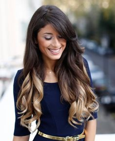 Beautiful dark brown or maybe it's black? With light ash blonde ish color at the bottom of her hair. I really can't decide how my ombre should look!