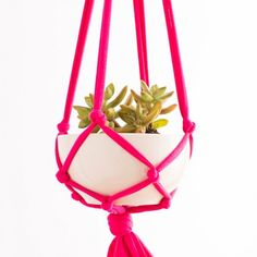 This macrame hanging planter is the perfect gift.