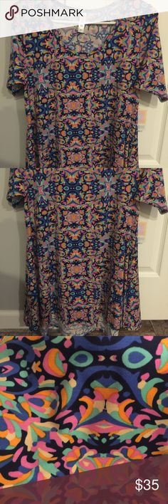 BNWT LuLaRoe Perfect T size Medium BNWT!!! Absolutely gorgeous print!! Size medium but can fit larger. LuLaRoe Tops Tees - Short Sleeve