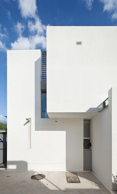 The front of this family home in South Korea comprises three blank white blocks, designed to shield views from the house opposite.