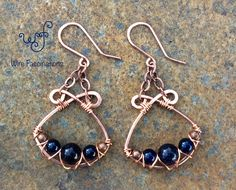 Handmade copper chandelier earrings: wire wrapped dark blue natural stone These handmade copper earrings feature wire wrapped dark blue natural stone beads (lapis and goldstone) handing from antique copper-plated brass chain in a chandelier style. Stone Earrings, Beaded Earrings, Earrings Handmade, Copper Earrings, Chandelier Earrings, Hoop Earrings, Handmade Jewellery, Copper Jewelry, Wire Jewelry