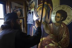 An iconographer from Vatopedis workshop painting a copy of the miracle-working icon of the Mother of God Paramythia. Byzantine Icons, Byzantine Art, Religious Icons, Orthodox Icons, Saint George, Painting Videos, Art Studios, Orthodox Christianity, Religion