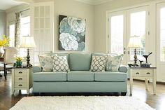 """The Daystar Sofa from Ashley Furniture HomeStore (AFHS.com). The """"Daystar-Seafoam"""" upholstery collection features stylishly shaped set-back arms along with the supportive seat and back cushion beautifully adorned with welt detailing to create an inviting contemporary styled collection that offers a refreshing look and the comfort perfect to enhance any living area."""