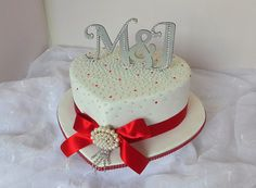 White, silver and red bling heart shaped wedding cake