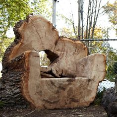 chair carved from a log | Found on naturesinstruments.com