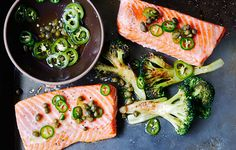 """This had me at """"chile-caper vinaigrette!"""" -- Roast Salmon and Broccoli with Chile-Caper Vinaigrette. Giving the broccoli a head start on the roast salmon in this one-pan dish lets it get nicely browned, coaxing out its natural sweetness. Salmon Recipes, Fish Recipes, Seafood Recipes, Dinner Recipes, Cooking Recipes, Healthy Recipes, Eat Healthy, Tilapia Recipes, Tasty Meals"""