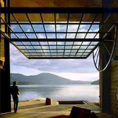 With their respect for place, @olsonkundig seamlessly integrates this #dream cabin into a bucolic lakeside landscape. The glass-and-steel door lifts to bring the great outdoors in. #design #architecture #outdoors #interiordesign... - Interior Design Ideas, Interior Decor and Designs, Home Design Inspiration, Room Design Ideas, Interior Decorating, Furniture And Accessories