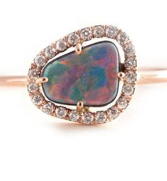 Rose gold, black opal, and a band of pavé diamonds make this engagement ring truly and spectacularly unique. #etsyweddings