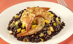 Black Rice with Shrimp, Mango and Wheat Germ Nutritious black rice, also known as purple rice or forbidden rice, typically turns deep purple when cooked. Its mild and nutty flavor pairs well with wheat germ. Shrimp, mango and cilantro top this colorful dish that's as pretty as it is tasty.