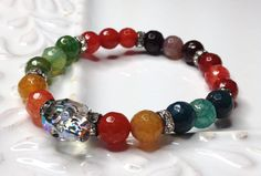 LOVE this Swarovski crystal skull:)) Crystal Skull Stretch Bracelet Colorful Fire Agate by LoveandLulu