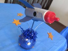 Outer Space themed baby shower center piece made from a baby bottle. SOOO CUTE! Have to!
