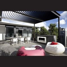 A pergola with adjustable louvres provides shade to the dining seating in the courtyard.