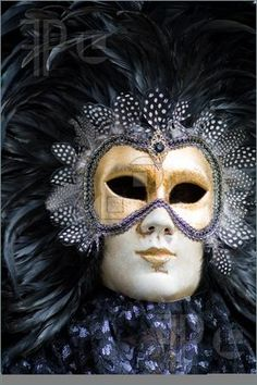 Photo of Carnival in venice with model dressed in various costumes and masks - black man