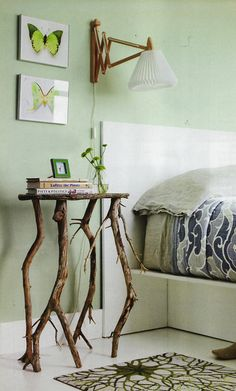 Table branches are lovely and juxtaposed nicely against green on walls and butterflies. ( Don't like the bed with this set up however). jvj