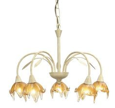 """The Oaks Fiorenza range is available from Luxury Lighting. And includes a 5 light ceiling pendant with complimenting wall light and table lamp all in a distressed cream/gold finish with delicate amber/clear glass """"flower"""" shades."""