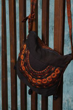 Fair Trade Brown Guatemalan Embroidered Shoulder Bag. 9 x 9.5 inches. Zipper close. Cotton. 40 inch shoulder strap.