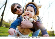 Young father playing on his son by Aliaksandr Khmialiou, via Shutterstock