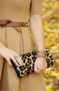 love the effect of the gold details and the contrast of leopard print with her tan dress and belt