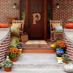 Mums, monograms and more! Check out our fabulous fall front door ideas: http://www.bhg.com/halloween/outdoor-decorations/pretty-front-entry-decorating-ideas-for-fall/?socsrc=bhgpin092513monogramandmums&page=31