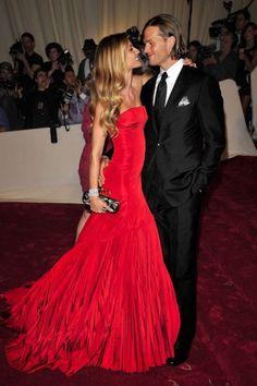 Gisele Bundchen—wearing a stunning Alexander McQueen gown—and Tom Brady.