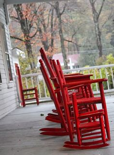 Red rockers on a front porch......why isn't someone rocking.