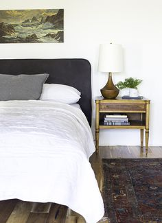 The New Guest Bedroom Bed. Love the subtle stripe with the dark greys and white