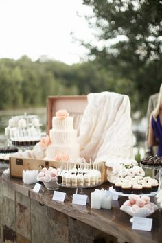 Cake in a vintage suitcase. Dessert table.