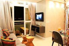 Sala de estar de um apartamento de 60 m², em Fortaleza. Projetado por Studio Toca.