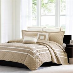 Create a neutral look within your bedroom with the Madison Park Addison Coverlet Collection. Made from pre-washed microfiber, this super soft set features an ivory and taupe color combination that can fit in with all your existing décor.