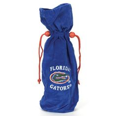 "$16.99-$21.25 14"" NCAA Florida Gators Velvet Wine Bottle Drawstring Bag - Florida Gators Wine Bag Item #11171 Officially licensed merchandise Bag has a drawstring and is done in your favorite teams official colors and logo  Dimensions: 14""H (holds a standard wine bottle) Material(s): polyester http://www.amazon.com/dp/B002N2L4R6/?tag=pin2wine-20"