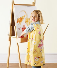 Pillowcase as Art Smock    Hold the pillowcase up to your little Picasso, measure, and cut out holes for the budding artist's head and arms. Gather the fabric between the neck hole and each armhole and tie with a ribbon for a better fit.