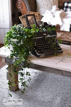 Vinage typewriter plant stand, vintage bingo cards, photos, part of a whole home JUNK tour via Funky Junk Interiors